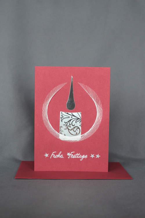 Rote Weihnachtskarte mit silber Kerze